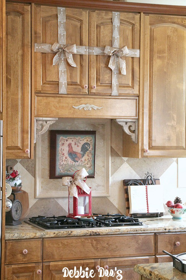 Decorating the cabinets with burlap ribbon and bows