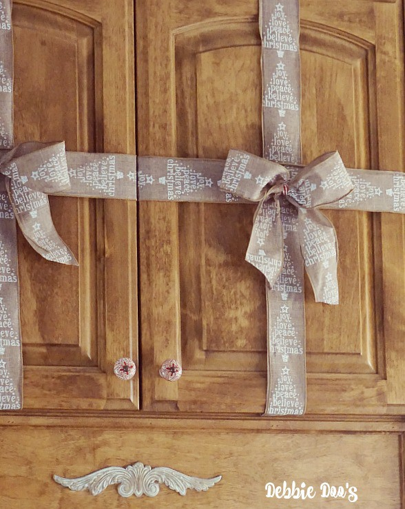 Present ribbon wrapping on cabinets for Christmas decor ideas