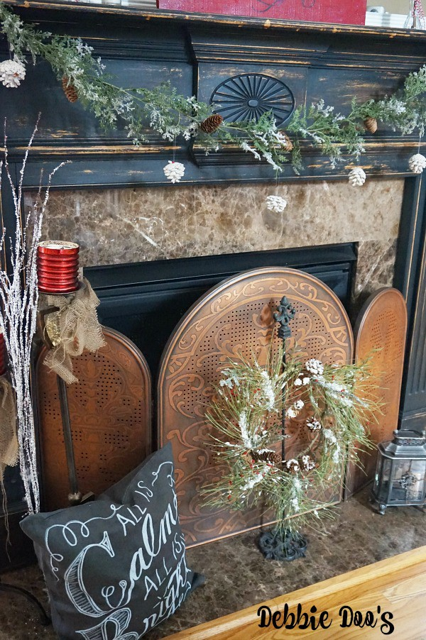 Transitioning from a Christmas mantel to a Winter mantel