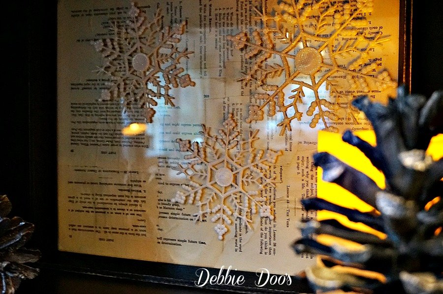 Winter frame snowflake craft idea with old book pages and mod podge