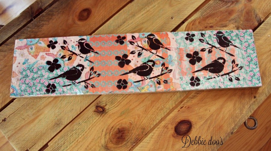 Make your own budget friendly spring art with scrap wood and mod podge paper