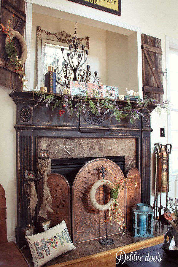 Rustic mantel decorated for Spring