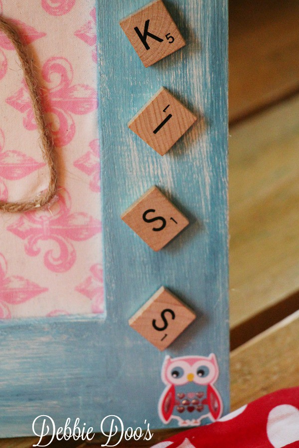 Scrabble letters on picture frame