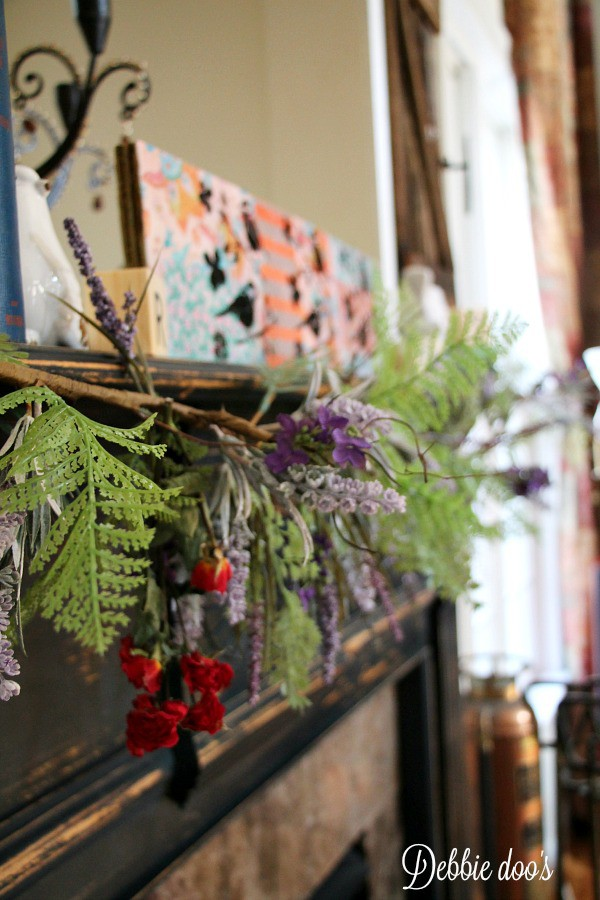 Spring mantel decor with birds and wild flowers