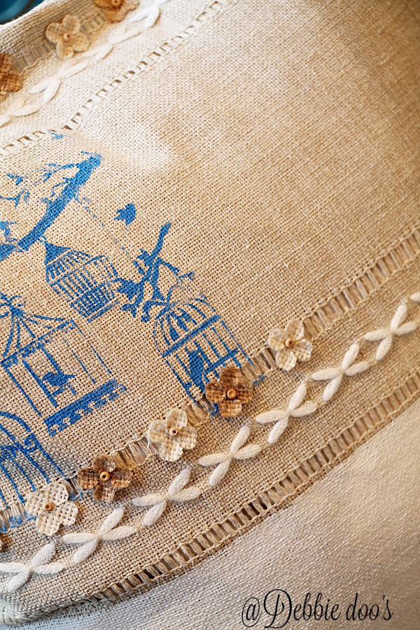 Burlap spring pillow idea with stencils and mini flower embellishments