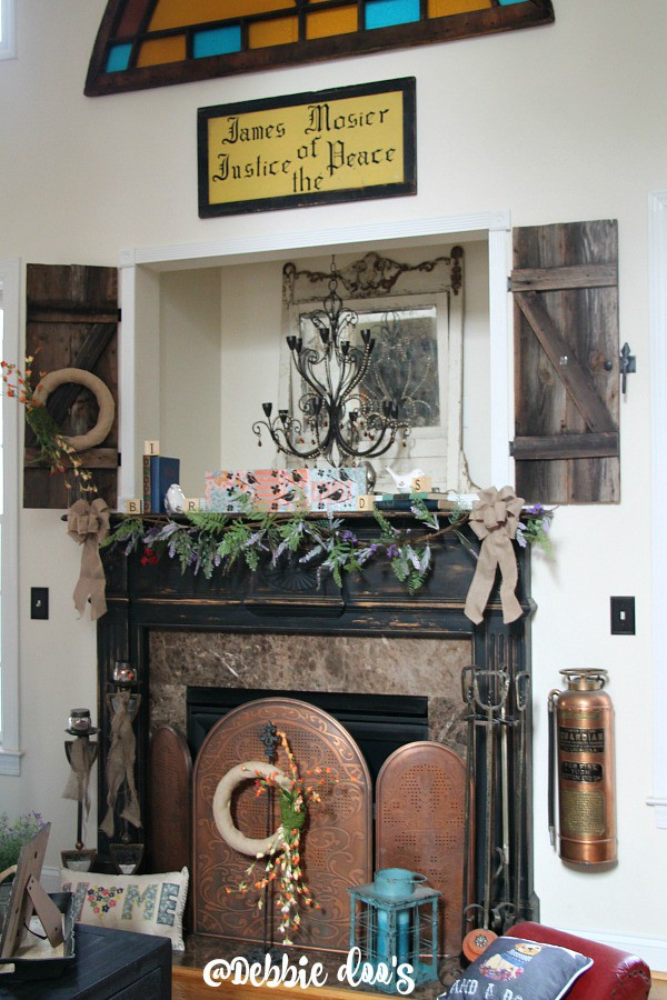 Spring mantel with burlap, birds and wildflowers