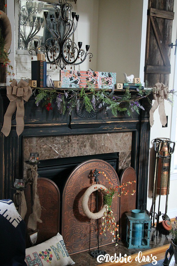 Spring mantel with wildflowers, birds and burlap