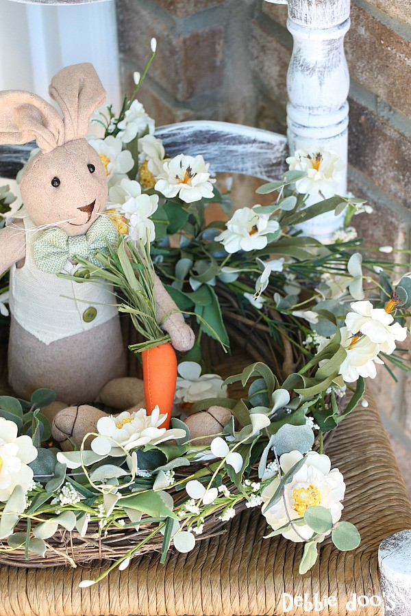 Spring wreath and bunny on a thrifty chair for the porch