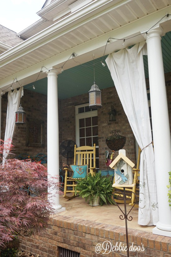 Porch with drop cloth curtains