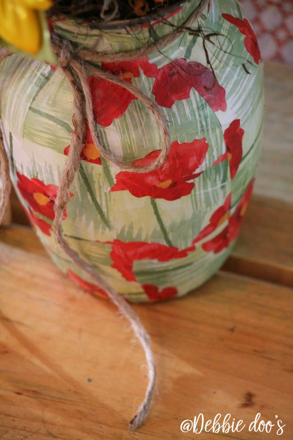 Mod podge a vase with wrapping paper