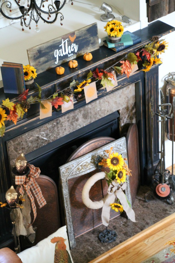 Fall mantel at Debbiedoo's with sunflowers, owls