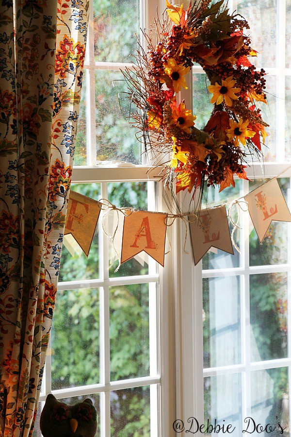 fall-wreath-in-the-kitchen-with-floral-fall-banner