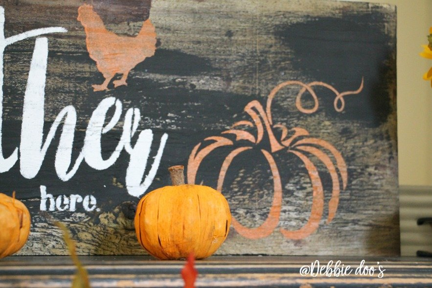 rustic-fall-mantel-sign-with-pumpkin-and-gather-here-stencil-by-debbiedoos