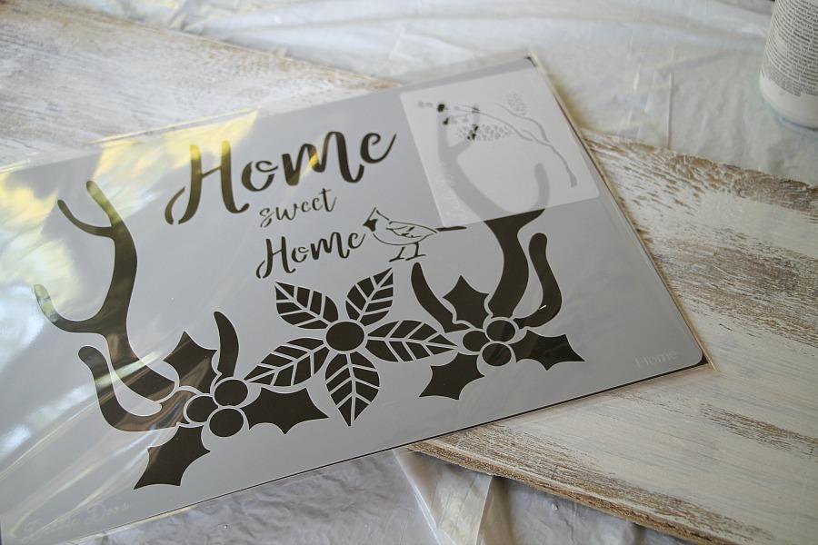 Debbiedoos-home-sweet-home-winter-stencil-with-cardinal-and-deer-antlers