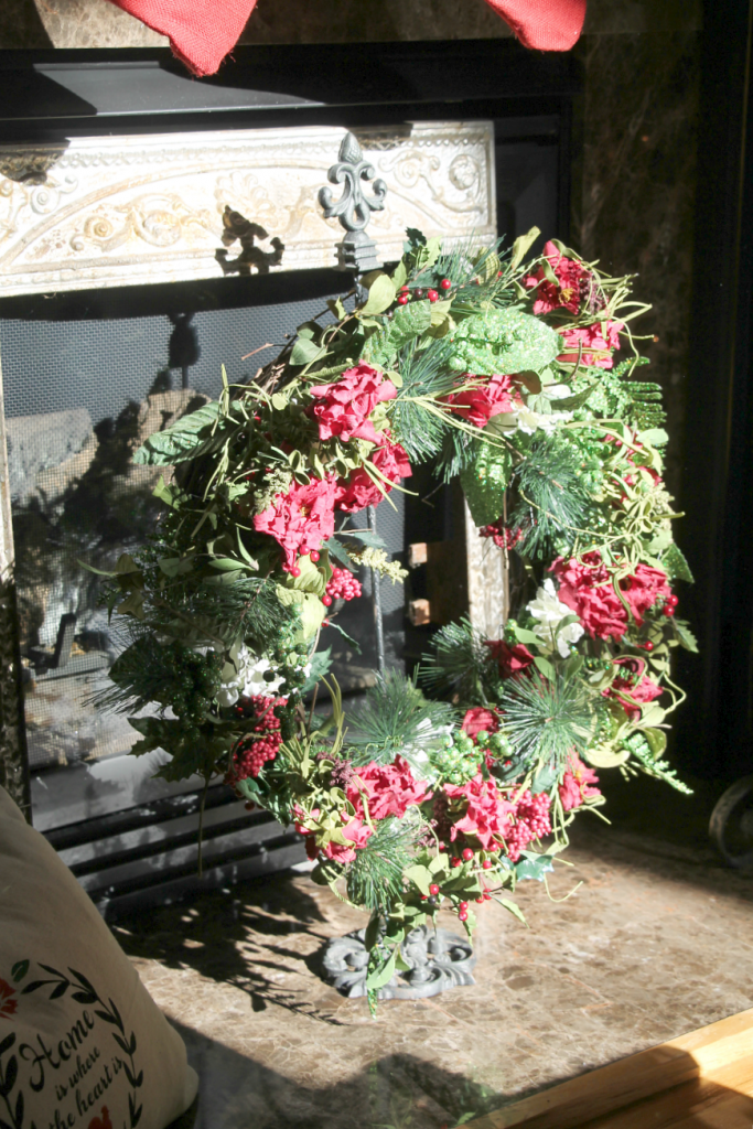 christmas-wreath-in-front-of-the-fireplace