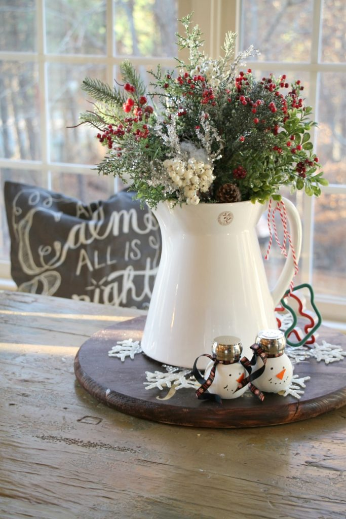 white-pitcher-filled-with-christmas-sprigs-for-the-kitchen-table