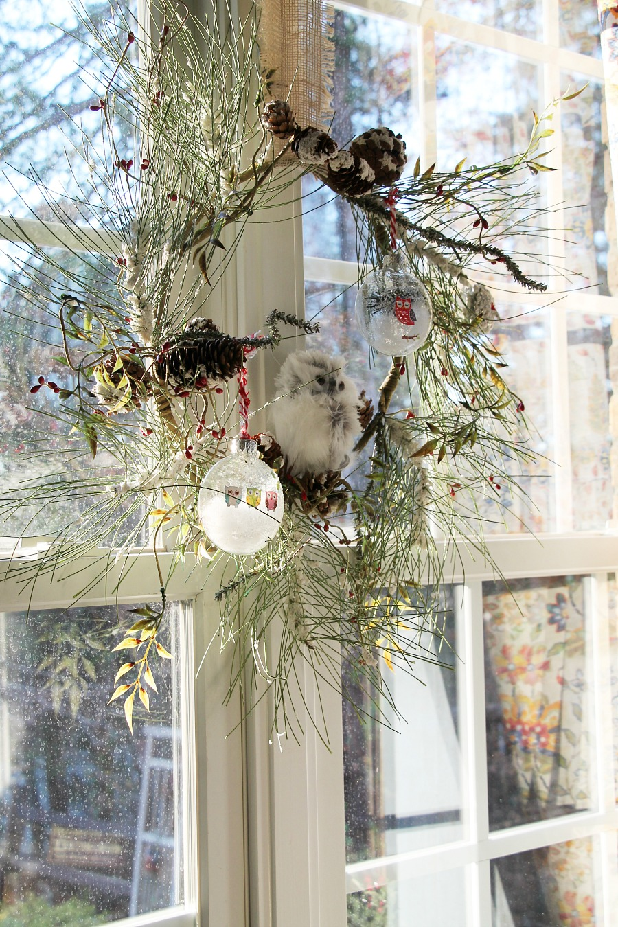 Wintery Pine Wreath In The Kitchen Window