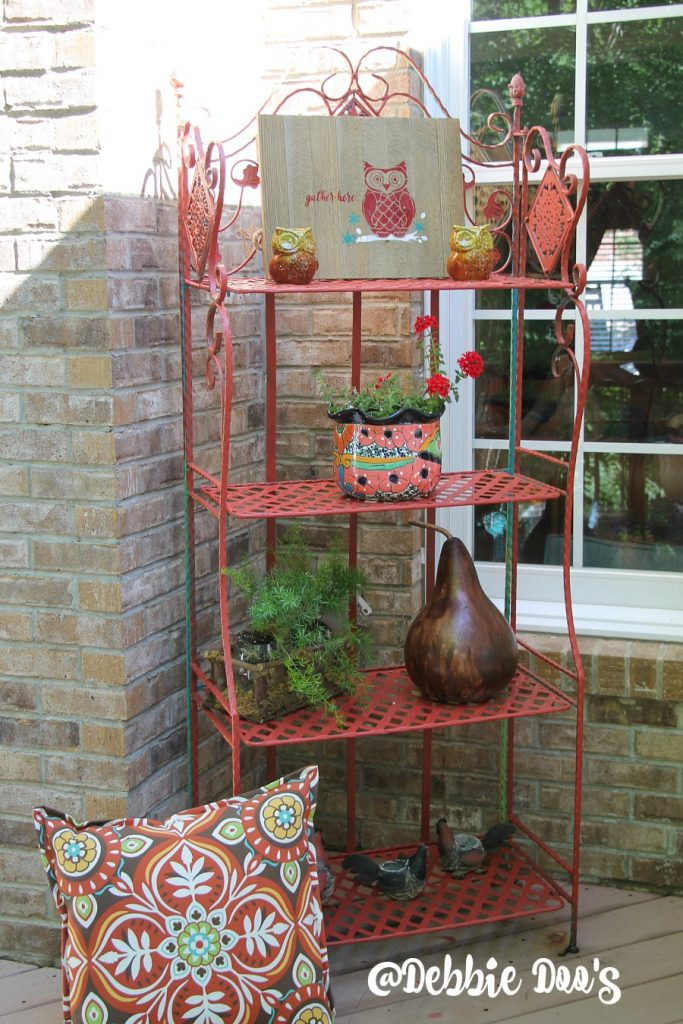 Rusty outdoor garden stand makeover with Beyond Paint