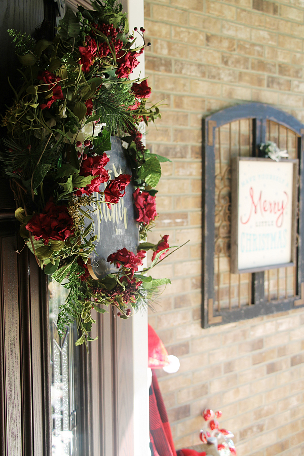 Welcoming Christmas porch entry with rustic and color designs