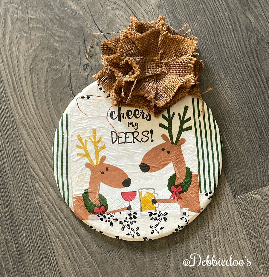 DIY Christmas sign with napkins and mod podge