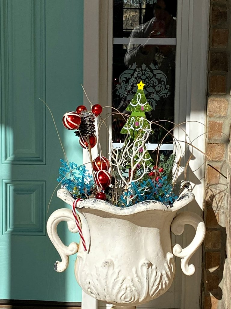 Christmas urns filled with ornaments, and Dollar tree decorations