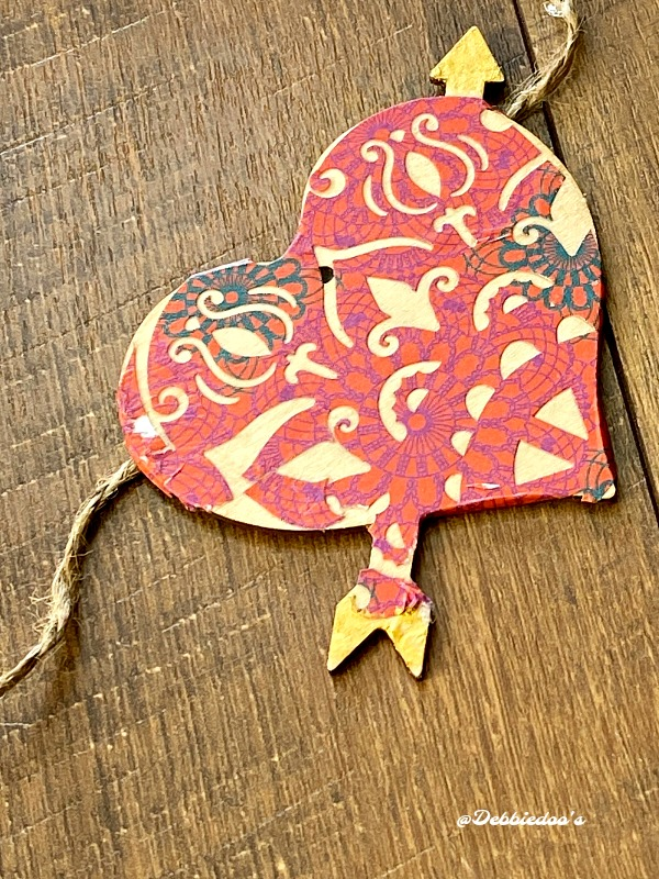 Mod podge on Valentine wood cut out hearts from Dollar tree