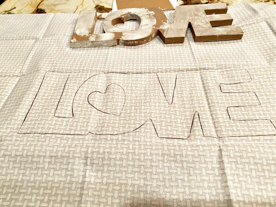 Mod podge on wood love sign from dollar tree