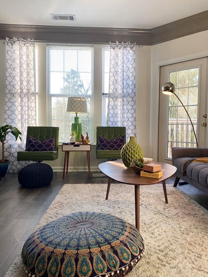 Boho living room with a mix of Mid century modern