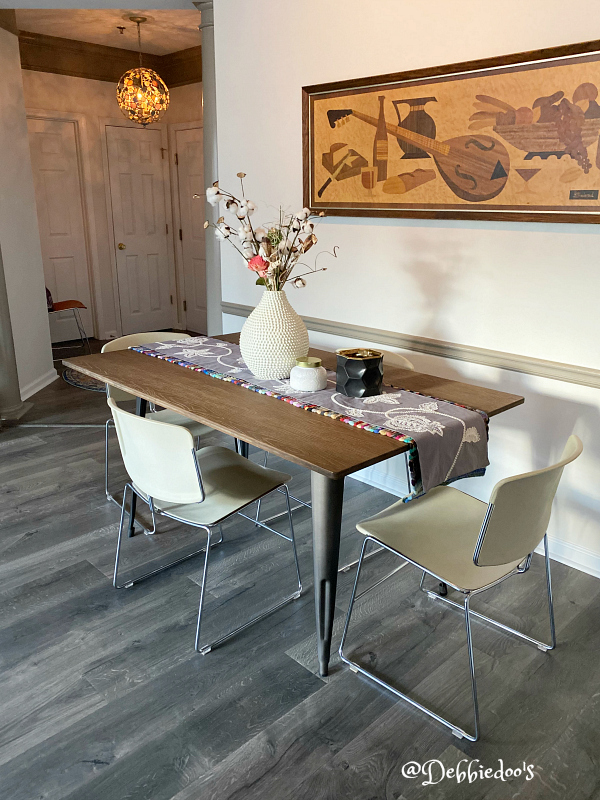 Small condo dining room with vintage chairs